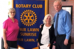 Joan Piela being inducted into The Fair Lawn Sunrise rotary